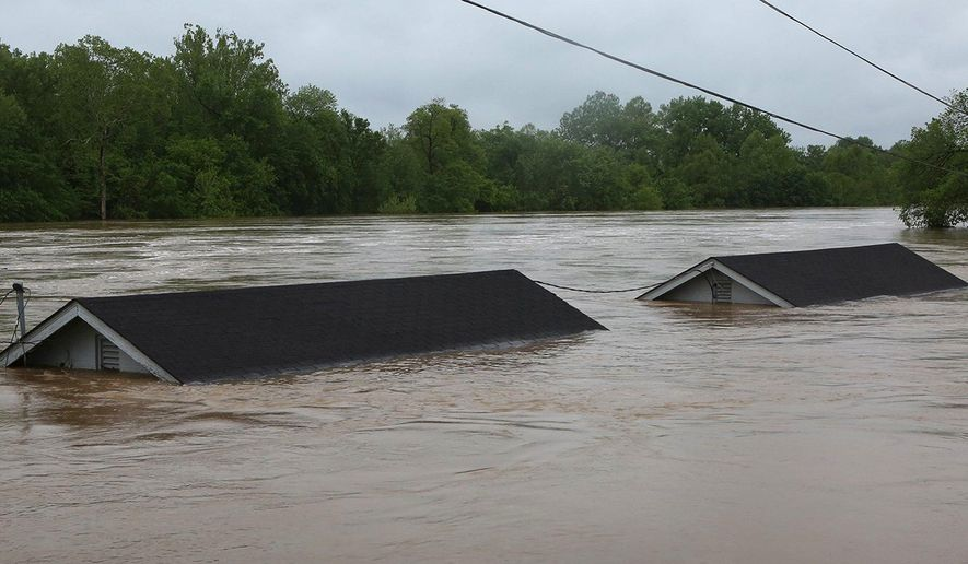 Two rental houses look underwater next to the Meramec River on Opps Lane in Fenton, Mo., Wednesday, May 3, 2017. Heavy rains have swollen many rivers to record levels in parts of Missouri, Illinois, Oklahoma and Arkansas. Five deaths have been blamed on flooding in Missouri, while hundreds of people have been displaced and thousands more are potentially in harm's way. (J.B. Forbes/St. Louis Post-Dispatch via AP)