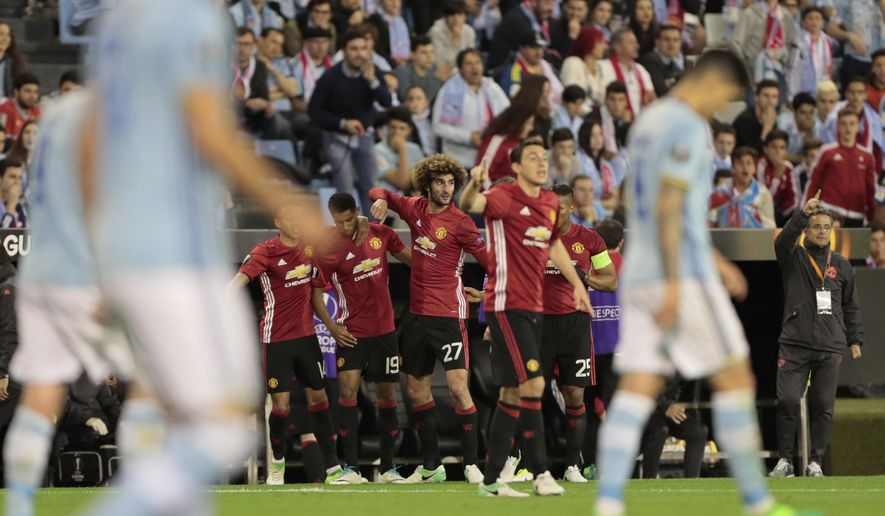 Manchester United players celebrate after Marcus Rashford scored the opening goal during a Europa League, semifinal, first leg soccer match between Celta and Manchester United at the Balaidos stadium in Vigo, Spain, Thursday May 4, 2017. (AP Photo/Lalo R. Villar)