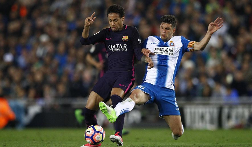 FC Barcelona's Neymar, left, duels for the ball against Espanyol's Javi Lopez during the Spanish La Liga soccer match between Espanyol and FC Barcelona at RCDE stadium in Cornella Llobregat, Spain, Saturday, April 29, 2017. (AP Photo/Manu Fernandez)