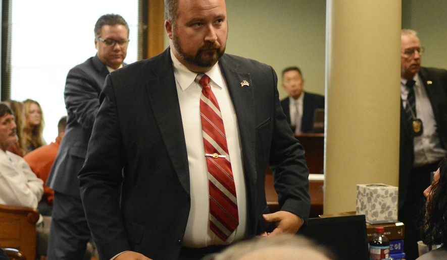 Ohio Rep. Wes Retherford, R-Hamilton, walks out of Butler County Area II Court after being found guilty of operating a vehicle while impaired and sentenced Wednesday, May 3, 2017, in Hamilton, Ohio. Retherford was sentenced by Judge Kevin McDonough to six months in jail. All of the time was suspended except for three days of an alcohol intervention program. (Michael D. Pitman/The Journal-News via AP)