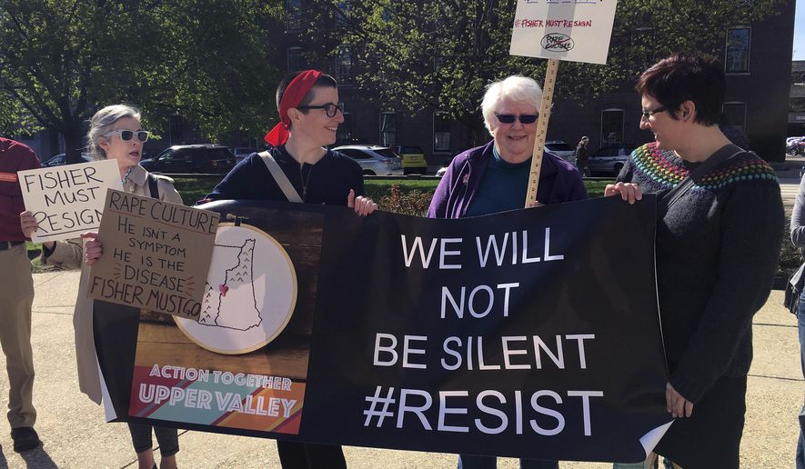 Protesters stand outside the Statehouse in Concord, N.H., on Thursday, May 4, 2017, to call for the resignation of Republican state Rep. Robert Fisher. Fisher has resisted calls for his resignation following revelations of online comments he has made degrading women. (AP Photo/Kathleen Ronayne)