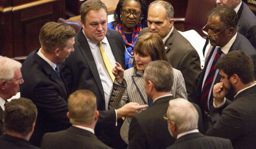 House Speaker Beth Harwell, R-Nashville, center, speaks with representatives and staff on the House floor in Nashville, Tenn., on Thursday, May 4, 2017. The chamber delayed a vote on the state's annual spending plan amid deep disagreements between Republicans over spending priorities. (AP Photo/Erik Schelzig)