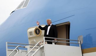 President Donald Trump steps off Air Force One during his arrival at JFK International Airport in New York, Thursday, May 4, 2017. Trump traveled to New York to meet for the first time with Australian Prime Minister Malcolm Turnbull and aim to move past the rocky start of their working relationship. (AP Photo/Pablo Martinez Monsivais)