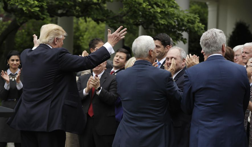 President Donald Trump acknowledges House Speaker Paul Ryan of Wis., in the Rose Garden of the White House in Washington, Thursday, May 4, 2017, after the House pushed through a health care bill. (AP Photo/Evan Vucci)
