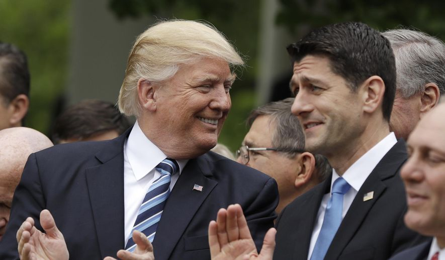 President Trump celebrated with Speaker Paul D. Ryan in the Rose Garden of the White House on Thursday after the House pushed through their long-awaited health care bill. (Associated Press) ** FILE **