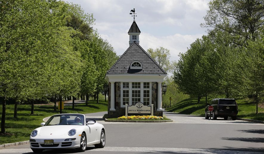 In this Tuesday, May 2, 2017, photo cars drive near the entrance to Trump National Golf Club Bedminster in Bedminster, N.J. Trump is expected to make regular weekend visits this summer to Bedminster. Bedminster is known for its rolling hills, horse farms and mostly two-lane roads. (AP Photo/Seth Wenig)