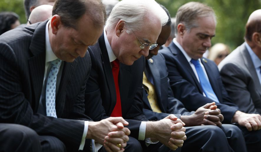 From left, Labor Secretary Alexander Acosta, Health and Human Services Secretary Tom Price, Housing and Urban Development Secretary Ben Carson, Veterans Affairs Secretary David Shulkin and Commerce Secretary Wilbur Ross pause in the Rose Garden of the White House in Washington, Thursday, May 4, 2017, prior to President Donald Trump signing an executive order aimed at easing an IRS rule limiting political activity for churches. (AP Photo/Evan Vucci)