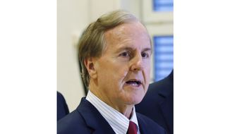 In this Monday Jan. 18, 2016, file photo, U.S. Rep. Robert Pittenger speaks to the media at the Landstuhl Regional Medical Center in Landstuhl, Germany. (AP Photo/Michael Probst, File)