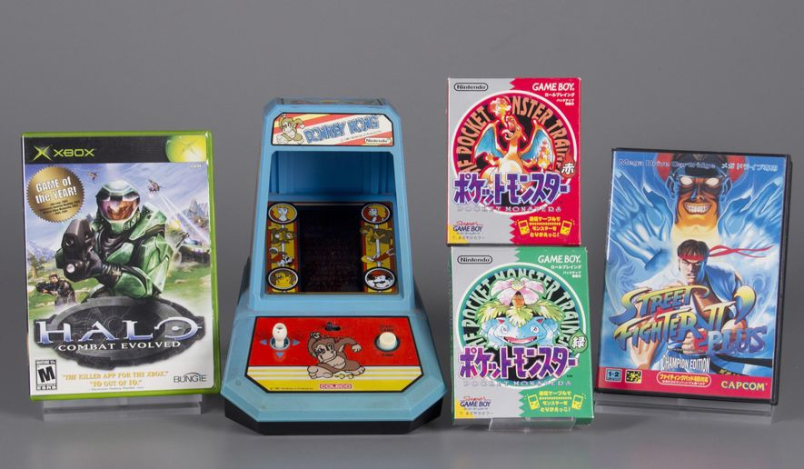 "This undated photo provided by The Strong shows the four inductees for the 2017 class of the World Video Game Hall of Fame. From left to right are: ''Halo: Combat Evolved,"" ""Donkey Kong,"" ""Pokemon Red and Green,"" and ''Street Fighter II."" (Bethany Mosher/The Strong via AP)"