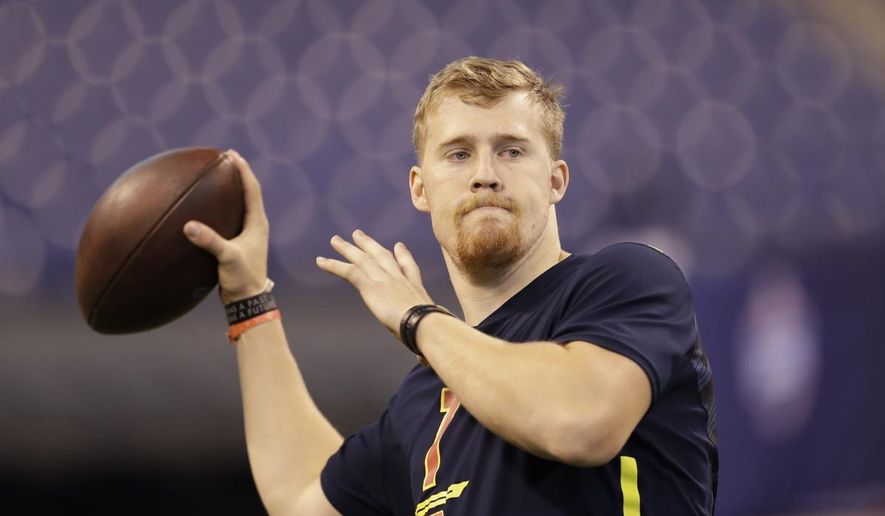 """FILE - In this March 4, 2017 file photo, Iowa quarterback C.J. Beathard runs a drill at the NFL football scouting combine in Indianapolis. Beathard said at times it was frustrating watching other quarterbacks put up more prolific numbers but the tutelage he received in a pro-style offense under coach Kirk Ferentz and coordinator Greg Davis is what made him attractive to the San Francisco 49ers in the draft last week. """"I think it really benefited me coming from a pro-style offense,"""" Beathard said Thursday, May 4, 2017, on the eve of his first practice as a pro. (AP Photo/David J. Phillip, File)"""