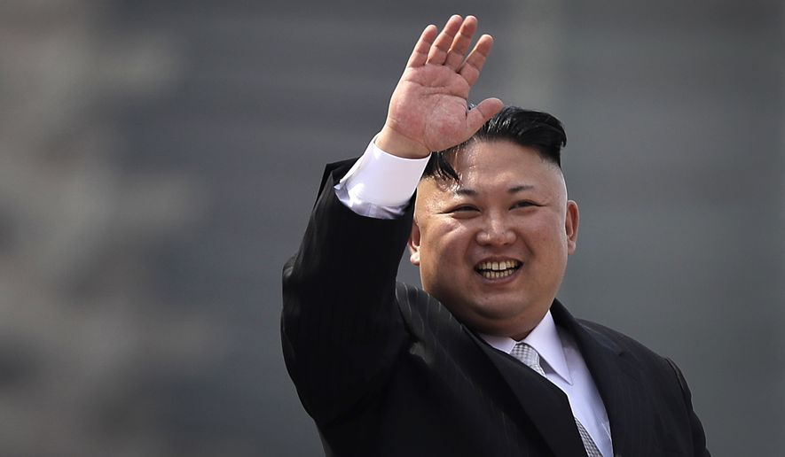 FILE - In this Saturday, April 15, 2017, file photo, North Korean leader Kim Jong Un waves during a military parade in Pyongyang, North Korea, to celebrate the 105th birth anniversary of Kim Il Sung, the country's late founder and grandfather of current ruler Kim Jong Un. North Korea has accused the U.S. and South Korean spy agencies of an unsuccessful assassination attempt on leader Kim Jong Un involving bio-chemical weapons. (AP Photo/Wong Maye-E, File) **FILE**