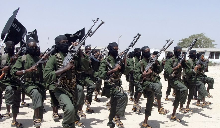 In this Thursday, Feb. 17, 2011, file photo, hundreds of newly trained al-Shabab fighters perform military exercises in the Lafofe area some 18 km south of Mogadishu, in Somalia. The U.S. military said Friday, May 5, 2017, that a service member has been killed in Somalia during an operation against the extremist group al-Shabab as the United States steps up its fight against the al-Qaeda-linked organization. (AP Photo/Farah Abdi Warsameh, File)