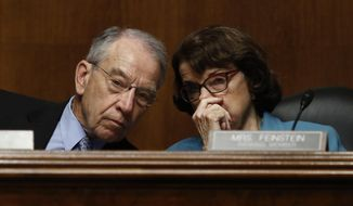 FILE - In this May 3, 2017 file photo, Senate Judiciary Committee Chairman Sen. Charles Grassley, R-Iowa talks with the committee's ranking member Sen. Dianne Feinstein, D-Calif. on Capitol Hill in Washington. Feinstein has said publicly that the FBI paid $900,000 to break into an iPhone of one of the San Bernardino, California, shooters.  (AP Photo/Carolyn Kaster, File)