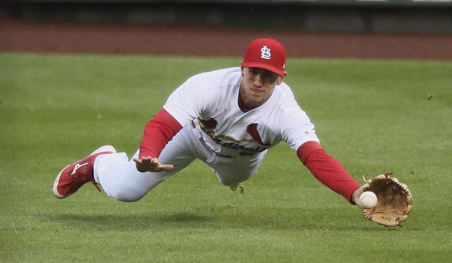 St. Louis Cardinals right fielder Stephen Piscotty dives for a single by Milwaukee Brewers' Keon Broxton in the second inning of a baseball game against the Milwaukee Brewers in St. Louis on Thursday, May 4, 2017. (Chris Lee/St. Louis Post-Dispatch via AP)