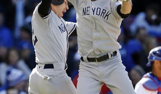 New York Yankees' Brett Gardner, right, celebrates with Jacoby Ellsbury after hitting a three-run home run against the Chicago Cubs during the ninth inning of an interleague baseball game Friday, May 5, 2017, in Chicago. (AP Photo/Nam Y. Huh)
