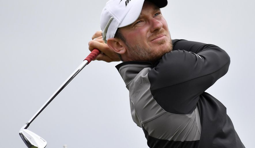 FILE - A Saturday, Nov. 26, 2016 file photo showing England's Chris Wood watching his tee shot on the sixth hole during his match at the World Cup of Golf at Kingston Heath in Melbourne, Australia. Golf gets another makeover this weekend when the European Tour rolls out its latest attempt at innovation, the inaugural GolfSixes tournament. Played over two days, GolfSixes is a six-hole match play event featuring two-man teams from 16 different countries competing for a prize fund of 1 million euros ($1.1 million). (AP Photo/Andrew Brownbill, File)