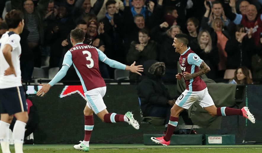 West Ham's Manuel Lanzini, right, celebrates after scoring during the English Premier League soccer match between West Ham United and Tottenham Hotspur at the London Stadium in London, Friday, May 5, 2017. (AP Photo/Kirsty Wigglesworth)