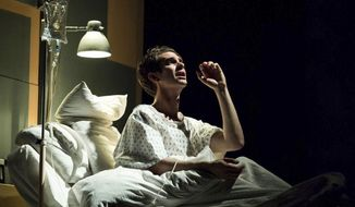 "In this undated photo made available Friday May 5, 2017, by The National Theatre, Andrew Garfield plays the lead during a hospital scene in the ""Angels in America"" production at Britain's National Theatre in London.  Tony Kushner's ""Angels in America"" is a  ""gay fantasia on national themes"" set in a deeply divided United States haunted by premonitions of apocalypse, and the two play eight-hour epic production is receiving rave reviews and selling out The National Theatre. (Helen Maybanks/National Theatre via AP)"