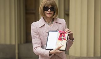 Editor-in-Chief, American Vogue and Artistic Director Dame Anna Wintour poses for a photo after receiving her Dame Commander insignia from Britain's Queen Elizabeth II at an Investiture ceremony at Buckingham Palace, London, Friday May 5, 2017. (Dominic Lipinski/PA Pool via AP)