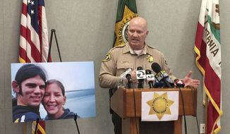Sonoma County Sheriff Steve Freitas speaks next to a photo of Jason Allen, left, Lindsay Cutshall at a news conference in Santa Rosa, Calif., Friday, May 5, 2017. Freitas says a suspect is in custody in the killings of Allen and Cutshall on a Northern California beach more than a decade ago. (AP Photo/Terry Chea)