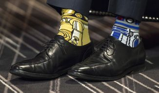 Canada's Prime Minister Justin Trudeau's Stars Wars-themed socks are seen as he meets with his Irish counterpart Enda Kenny Thursday, May 4, 2017, in Montreal. (Paul Chiasson/The Canadian Press via AP)