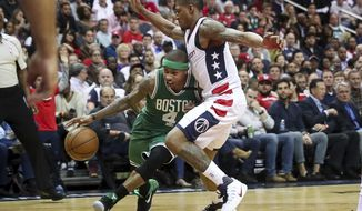 Boston Celtics guard Isaiah Thomas (4) drives on Washington Wizards guard Bradley Beal (3) during the second half in Game 3 of a second-round NBA playoff series basketball game, Thursday, May 4, 2017, in Washington. (AP Photo/Andrew Harnik)