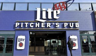 In this Wednesday, May 3, 2017 photo, a man walks into Pitcher's Pub inside Comerica Park in Detroit.  A University of Michigan graduate says she was denied service by a Comerica Park waitress and ballpark ball manager who refused to recognize her U.S. government-issued green card as proof of age. (Robin Buckson /Detroit News via AP)