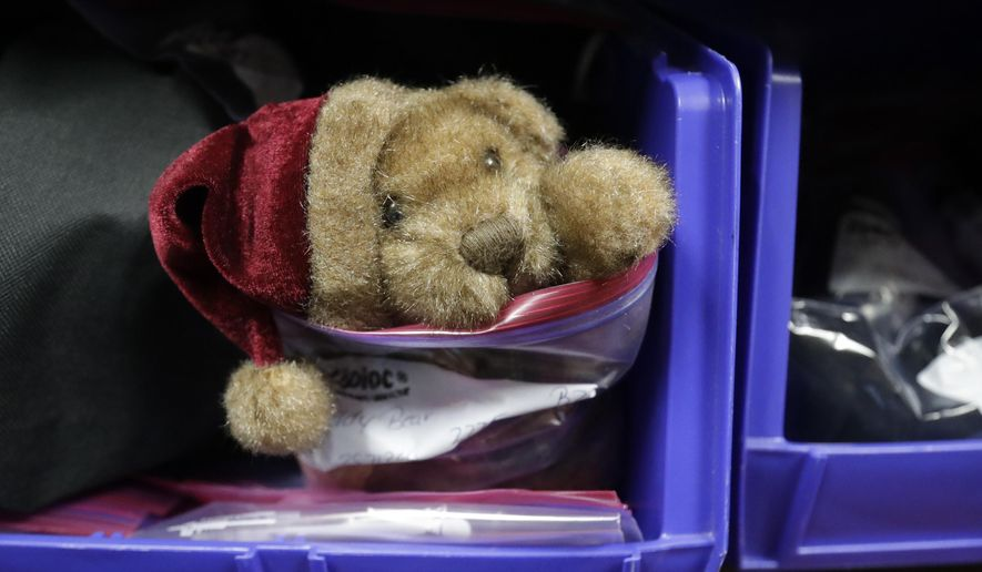 A stuffed toy bear left behind by a traveler is seen during a tour of the Transportation Security Administration's lost and found at the Detroit Metropolitan Airport, Friday, May 5, 2017, in Romulus, Mich. In the first four months of this year the agency has collected 158 laptops, 59 cellphones and nearly 700 pairs of eyeglasses. Dozens of bins hold toys, magazines, wallets, keys and more. Spokesman Michael McCarthy says the agency holds most items for about 30 days. If unclaimed, they're given to the state of Michigan's surplus office, which donates, auctions or repurposes them. (AP Photo/Carlos Osorio)