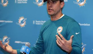 Miami Dolphins head coach Adam Gase gestures as he speaks during a news conference, Friday, May 5, 2017, at the team's NFL football training facility in Davie, Fla. Gase's background is on offense, but he doesn't mind that the Dolphins focused on defense in last week's draft. (AP Photo/Wilfredo Lee)
