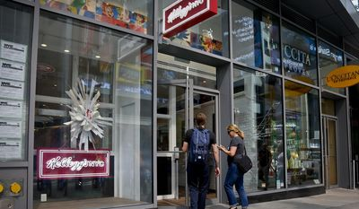 FILE - In this Tuesday, July 12, 2016, file photo, customers enter the new Kellogg's NYC cafe in New York's Times Square. Kellogg Co. reports earnings, Thursday, May 4, 2017. (AP Photo/Bebeto Matthews, File)