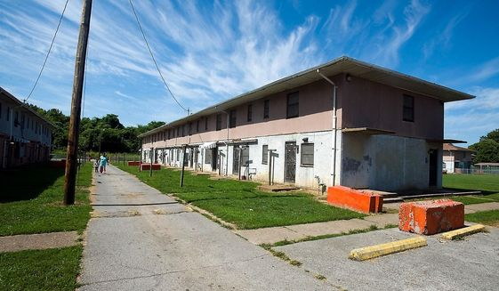 This Aug. 20, 2015, file photo shows the McBride apartments, a family-designated public housing complex of the Alexander County Housing Authority, in Cairo, Ill. (Richard Sitler/The Southern Illinoisan via AP) ** FILE **