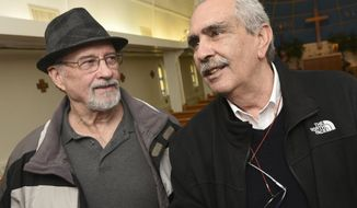 ADVANCE FOR WEEKEND EDITIONS - In this Tuesday, April 25, 2017, photo, Victor Fogelsonger, left, Chambersburg, Pa., chats with his half-brother Roberto DeAngelis for the first time at Letterkenny Chapel in Chambersburg, Pa. Their father was a POW at Letterkenny and helped to build the chapel during WWII. The POW fathered Victor before returning to Italy after he was released. (Markell DeLoatch/Public Opinion via AP)