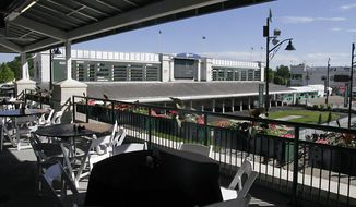 In this Tuesday, May 2, 2017 photo, the Champions Lounge outdoor seating area, part of the ongoing renovations at Churchill Downs, provides an impressive view of the paddock and the walking ring at Churchill Downs in Louisville, Ky. Churchill Downs' parent company has pumped $250 million into renovations since the early 2000s. But many have catered to well-heeled fans willing to shell out thousands of dollars for panoramic views, sumptuous buffets, access to betting windows and restrooms without lines, and demand outpaces available seating. That's leaving the middle class squeezed out. (AP Photo/Garry Jones)