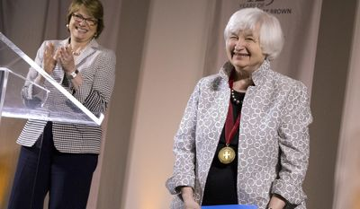 Brown University President Christina Paxson applauds at left Federal Reserve Chair Janet Yellen following Yellen's speech during a conference at Brown in Providence, R.I., Friday, May 5, 2017.(AP Photo/Michael Dwyer)