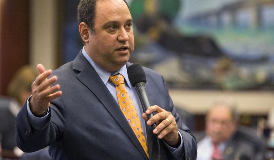 Rep. Ray Rodrigues, R-Estero, answers questions on medical marijuana bill, HB 1397, on the floor at the Florida Capitol, Friday May 5, 2017, in Tallahassee, Fla. (AP Photo/Mark Wallheiser)