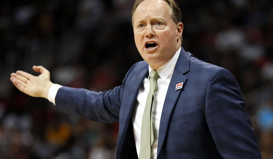 FILE - In this April 9, 2017, file photo, Atlanta Hawks head coach Mike Budenholzer reacts during the second half of an NBA basketball game against the Cleveland Cavaliers in Atlanta. Budenholzer resigned as the Hawks' president of basketball operations and will remain as coach, the team announced on Friday, May 5, 2017. (AP Photo/Todd Kirkland, File)