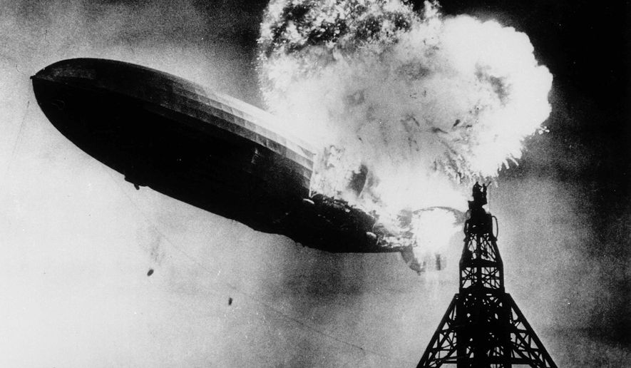 """FILE - This May 6, 1937 file photo, provided by the Philadelphia Public Ledger, was taken at almost the split second that the Hindenburg exploded over the Lakehurst Naval Air Station in Lakehurst, N.J. Only one person is left of the 62 passengers and crew who survived when the Hindenburg burst into flames 80 years ago Saturday, May 6, 2017. Werner Doehner was 8 years old when he boarded the zeppelin with his parents and older siblings after their vacation to Germany in 1937. The 88-year-old now living in Parachute, Colo., tells The Associated Press that the airship pitched as it tried to land in New Jersey and that """"suddenly the air was on fire."""" (AP Photo, File)"""