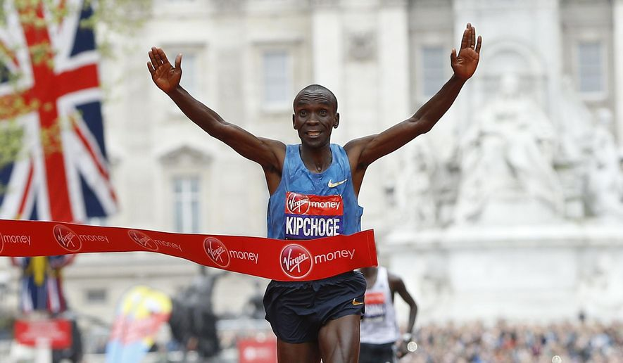 FILE - In this Sunday, April 26, 2015 file photo, Eliud Kipchoge of Kenya wins the Men's race in the 35th London Marathon. On the 63rd anniversary of Roger Bannister breaking the four-minute mile, three elite athletes will attempt to do something arguably more extraordinary, run the first sub-two-hour marathon. Olympic marathon champion Eliud Kipchoge leads the attempt on Saturday, May 6, 2017 at Monza's Formula One racecourse, along with two-time Boston Marathon winner Lelisa Desisa, from Ethiopia, and Eritrean half-marathon world-record holder Zersenay Tadese. (AP Photo/Kirsty Wigglesworth, File)