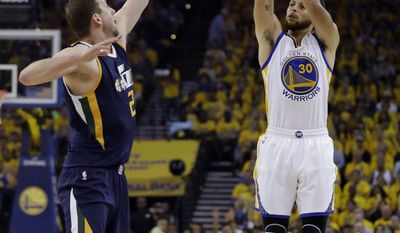 Golden State Warriors' Stephen Curry, right, shoots over Utah Jazz's Joe Ingles during the first half in Game 2 of an NBA basketball second-round playoff series, Thursday, May 4, 2017, in Oakland, Calif. (AP Photo/Marcio Jose Sanchez)