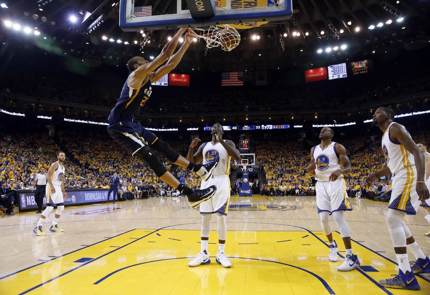 Utah Jazz's Rudy Gobert, top left, dunks against the Golden State Warriors during the first half in Game 2 of an NBA basketball second-round playoff series, Thursday, May 4, 2017, in Oakland, Calif. (AP Photo/Marcio Jose Sanchez)