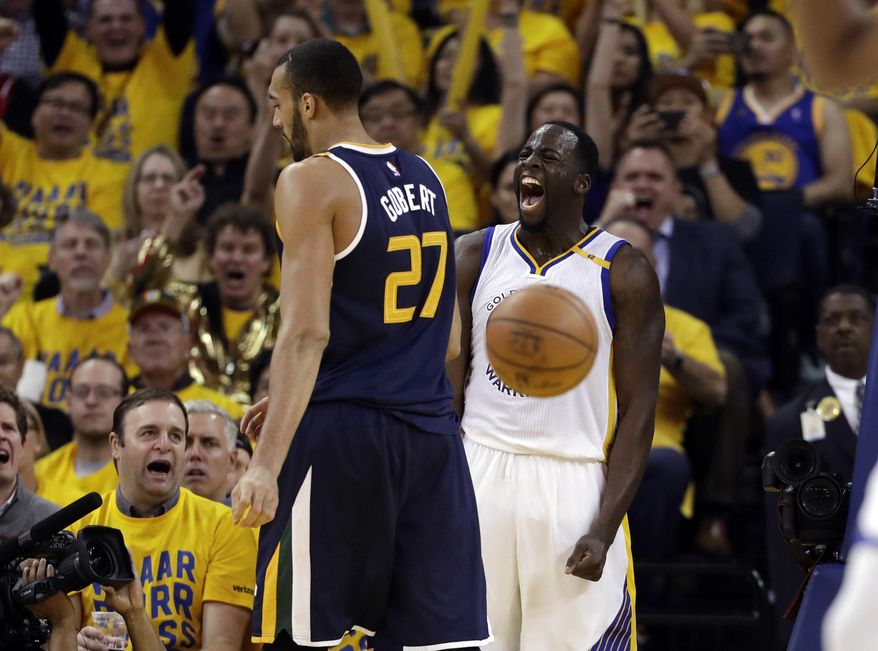 Golden State Warriors' Draymond Green, right, celebrates after scoring next to Utah Jazz's Rudy Gobert (27) during the second half in Game 2 of an NBA basketball second-round playoff series, Thursday, May 4, 2017, in Oakland, Calif. (AP Photo/Marcio Jose Sanchez)