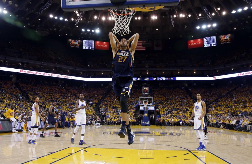 Utah Jazz's Rudy Gobert (27) dunks against the Golden State Warriors during the first half in Game 2 of an NBA basketball second-round playoff series, Thursday, May 4, 2017, in Oakland, Calif. (AP Photo/Marcio Jose Sanchez)