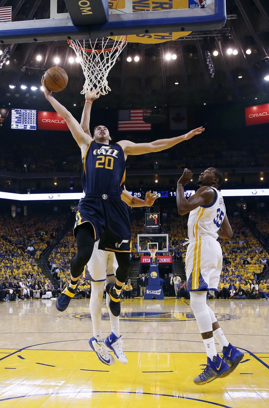 Utah Jazz's Gordon Hayward (20) drives past Golden State Warriors' Kevin Durant, right, during the first half in Game 2 of an NBA basketball second-round playoff series, Thursday, May 4, 2017, in Oakland, Calif. (AP Photo/Marcio Jose Sanchez)