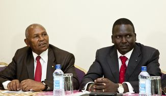 Incumbent head of the troubled National Olympic Committee of Kenya Kipchoge 'Kip' Keino, left, and candidate Paul Tergat, right, speak to the media on the day committee elections were supposed to take place in Nairobi, Kenya Friday, May 5, 2017. The Kenyan Olympic committee elections have been called off after one of the sports federations barred from voting obtained a court order. (AP Photo/Sayyid Abdul Azim)