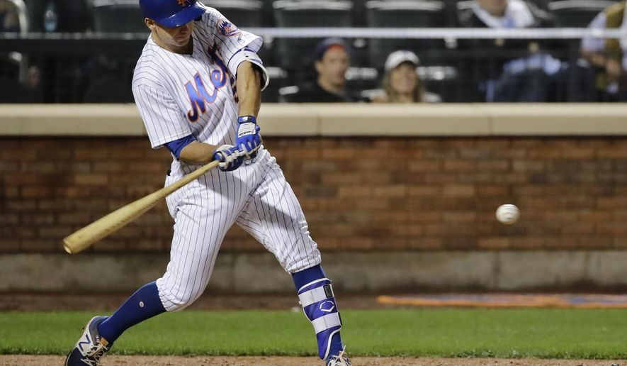 New York Mets' T.J. Rivera (54) hits a two-run double during the seventh inning of a baseball game against the Miami Marlins Friday, May 5, 2017, in New York. (AP Photo/Frank Franklin II)