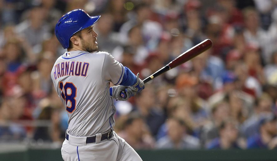 FILE - In this April 28, 2017, file photo, New York Mets' Travis d'Arnaud watches his three-run home run during the fourth inning of the team's baseball game against the Washington Nationals in Washington. Mets' d'Arnaud has been placed on the 10-day disabled list with a bruised right wrist, the latest setback for a New York team beset by several key injuries already this season. (AP Photo/Nick Wass, File)