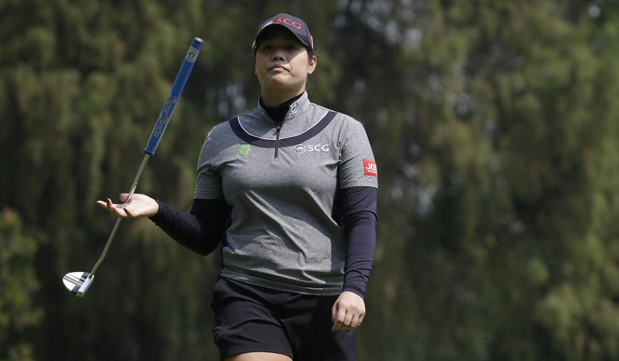 Ariya Jutanugarn, of Thailand, twirls her club as she walks off the 9th hole during round two of the Lorena Ochoa Invitational at Mexico Golf Club in Mexico City, Friday, May 5, 2017. The invitational, the tenth of the 2017 LPGA tour, is the tour's first Match Play event since 2012. (AP Photo/Rebecca Blackwell)