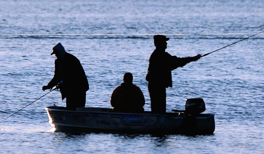 FILE - In this May 9, 2009, file photo, anglers cast their lines in the early morning during the Governor's Fishing Opener on White Bear Lake in White Bear Lake, Minn. The 70th annual Minnesota Governor's Fishing Opener will take place May 11-14, 2017, in the St. Cloud area. (Ben Garvin/St. Paul Pioneer Press via AP, File)