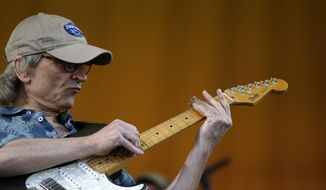 Blues guitarist Sonny Landreth plays the slide guitar at the New Orleans Jazz and Heritage Festival in New Orleans, Friday, May 5, 2017. (AP Photo/Gerald Herbert)