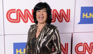 Christiane Amanpour of CNN reacts to photographers at the CNN Worldwide All-Star Party in Pasadena, Calif.  (Photo by Chris Pizzello/Invision/AP) ** FILE **